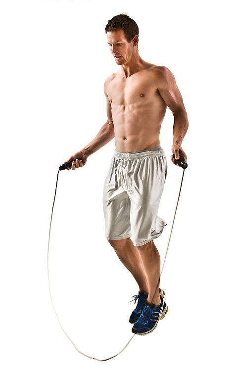 Fitness shots in studio, a man jumping rope