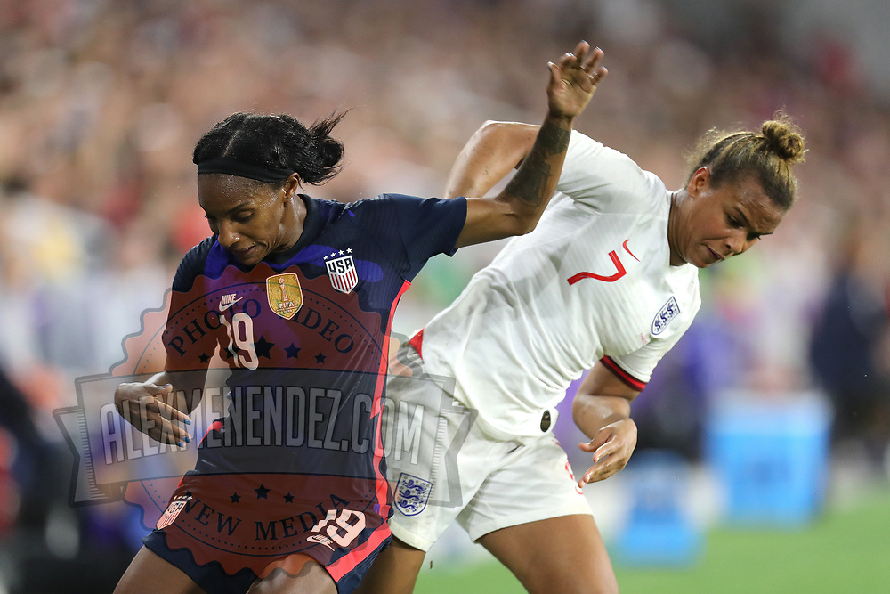United States defender Crystal Dunn (19) and England forward Nikita Parris (7) fight for the ball during the first match of the 2020 She Believes Cup soccer tournament at Exploria Stadium on 5 March 2020 in Orlando, Florida USA.