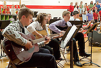 The Laconia High School guitar ensemble accompanies the LHS mixed chorus during Tuesday evening's Spring Concert in the LHS auditorium.  (Karen Bobotas/for the Laconia Daily Sun)