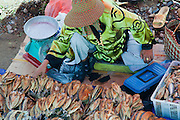 A woman selling dried fish in the market at Nabalu, Sabah