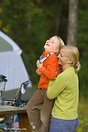 Kirsten Sabin with six year old daughter Elise having fun at campsite near Whitefish Montana model released