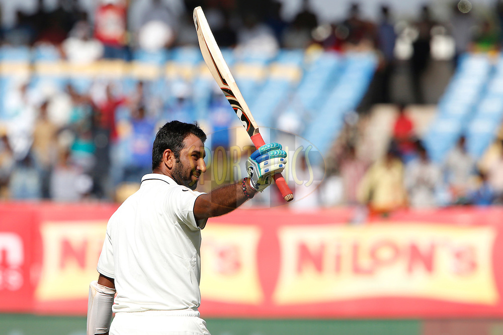 Cheteshwar Pujara of India celebrates his Hundred runs during day 3 of the first test match between India and England held at the Saurashtra Cricket Association Stadium , Rajkot on the 11th November 2016.<br /> <br /> Photo by: Deepak Malik/ BCCI/ SPORTZPICS