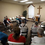 Cecily Rohrs leads the Wednesday service at St. Martin's Lutheran Church in Archbold, Ohio, on Wednesday, July 25, 2018. Although she is not the pastor, she switches off sometimes with Pastor Paul Reichert to lead services. Reichert can be seen two rows to the left of Rohrs in this photo. THE BLADE/KURT STEISS