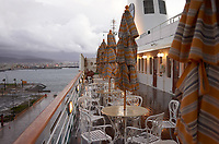 """(Image nine of nine) Panorama of the Ensenada harbor in Mexico on a grey and raining day from the deck of the MV World Odyssey. The other cruse ship is the Carnival Imagination. Once all of the students, faculty, staff, and life long learners were aboard we would be ready to begin the 102 day """"round the world"""" Semester at Sea Spring 2016 Voyage. Composite of nine images taken with a Leica T camera and 23 mm f/2 lens (ISO 250, 23 mm, f/2, 1/80 sec). Panorama stitched using AutoPano Giga Pro."""