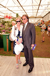 Th 2010 Royal Horticultural Society Chelsea Flower show in the grounds of Royal Hospital Chelsea, London on 24th May 2010.<br /> <br /> Picture shows:-RICHARD CARING and his wife JACKIE