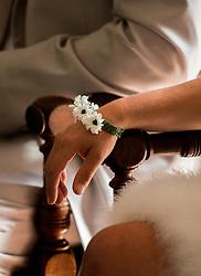 wedding flower bracelet detail during the vows