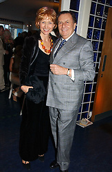 Comedian BARRY HUMPHRIES and his wife LIZZY at a party hosted by Sonia & Andrew Sinclair at The Westminster Boating Base, 136 Grosvenor Road, London SW1 on 5th June 2006.<br /><br />NON EXCLUSIVE - WORLD RIGHTS