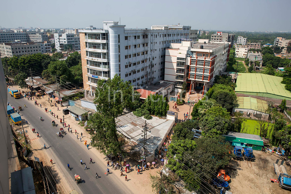Workers file out onto the street of the Setara Group garment factory on the 1st of October 2018 in Dhaka, Bangladesh.The Setara Group make clothing garments for many international brands including Tesco, H&M, Walmart, Sears, Carrefour and Target.