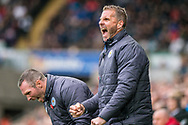 caretaker Manager of Leicester City, Michael Appleton (l) and his assistant Mike Sewell ® celebrate and react after Leicester's second Goal. Premier league match, Swansea city v Leicester city at the Liberty Stadium in Swansea, South Wales on Saturday 21st October 2017.<br /> pic by Aled Llywelyn, Andrew Orchard sports photography.