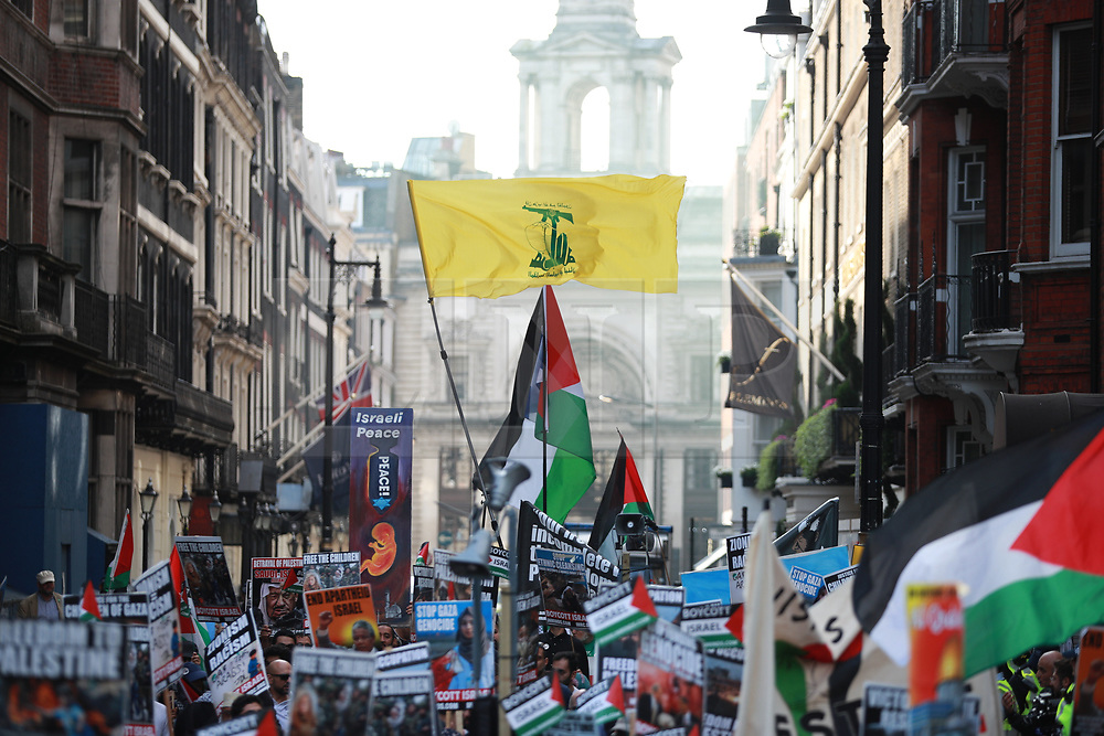 © Licensed to London News Pictures. 10/06/2018. London, UK. Hezbollah flag flying about the annual Al Quds day march in support of the Palestinian cause, in central London. A counter demonstration by far-right and Zionest groups also takes place. Photo credit: Joel Goodman/LNP