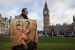 © licensed to London News Pictures. London, UK 05/12/2012. Artist Kaya Mar standing in Parliament Square with his paint to protest against the Chancellor Osborne ahead of Autumn Statement. Photo credit: Tolga Akmen/LNP