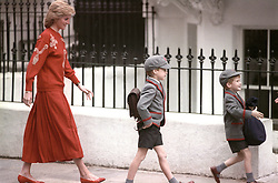 File photo dated 15/09/89 of Diana, Princess of Wales following her sons Prince Harry (right), then five years old, and Prince William, then seven, on Harry's first day at the Wetherby School in Notting Hill, West London. The Duchess of Cambridge will miss taking Prince George to his first day at school because she is suffering from severe morning sickness.