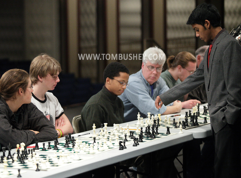 Middletown - Chess champion Deepak Aaron, right,  plays 32 opponents in an exhibition at Middletown High School on Saturday, Jan. 30, 2010. Aaron recently won the North American Youth Chess Championship in the Under-16 category. He is a master candidate.