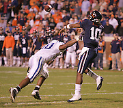 Duke cornerback Lee Butler (20) puts pressure on Virginia quarterback Jameel Sewell (10) during an ACC football game Saturday in Charlottesville, VA. Duke won 28-17. Photo/Andrew Shurtleff