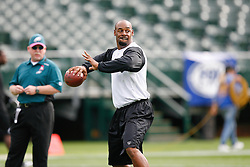 Philadelphia Eagles quarterback Donovan McNabb #5 warms up before the NFL game between the Philadelphia Eagles and the Oakland Raiders. The Raiders won 13-9 at The Oakland-Alameda County Coliseum in Oakland, California. (Photo By Brian Garfinkel)
