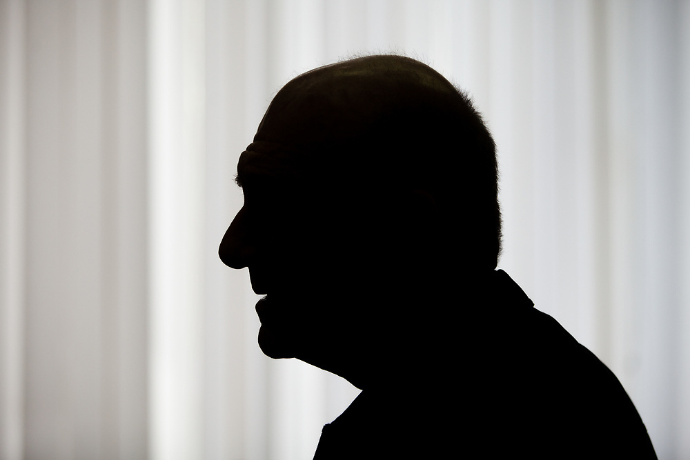 Former Israeli Prime Minister Ehud Olmert is silhouetted as he awaits the start of a hearing in his trial, at the courtroom of the Magistrates Court in Jerusalem, Israel, on February 2, 2016. The court has convicted Olmert on two counts of obstruction of justice for pressuring a confidant not to testify in multiple legal cases against him. The ruling follows a plea bargain agreement Olmert signed last month, in which he pleaded guilty to the charges of  bribery over his ties to to the construction of the massive Holyland residential complex when he served as the mayor of Jerusalem, in one of the worst corruption scandals in Israeli history.