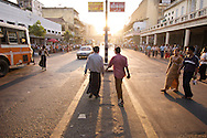 People socialize as they walk home and finish up the day's business in Yangon, Myanmar (Rangoon, Burma).
