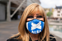 Edinburgh, Scottish Borders, Scotland, UK. 2  May 2021. ALBA party women candidates  gathered outside the Scottish Parliament to highlight the ALBA Women and Equalities policy. Under the hashtag Women Voting With Our Feet, hundreds of pairs of women's shoes were laid out in front of Scottish Parliament with messages of support for sex-based rights of women. ALBA list candidate  Tasmina Ahmed-Sheikh said that ALBA are making it loud and clear that they will always stand up for women's sex based rights and that women and girls will always be respected by ALBA. Pic; candidate Heather McLean. <br /> Iain Masterton/Alamy Live News