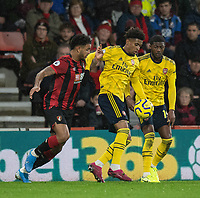 Bournemouth's Joshua King (left) battles with Arsenal's Reiss Nelson (centre) and Ainsley Maitland-Niles (right) <br /> <br /> Photographer David Horton/CameraSport<br /> <br /> The Premier League - Bournemouth v Arsenal - Thursday 26th December 2019 - Vitality Stadium - Bournemouth<br /> <br /> World Copyright © 2019 CameraSport. All rights reserved. 43 Linden Ave. Countesthorpe. Leicester. England. LE8 5PG - Tel: +44 (0) 116 277 4147 - admin@camerasport.com - www.camerasport.com