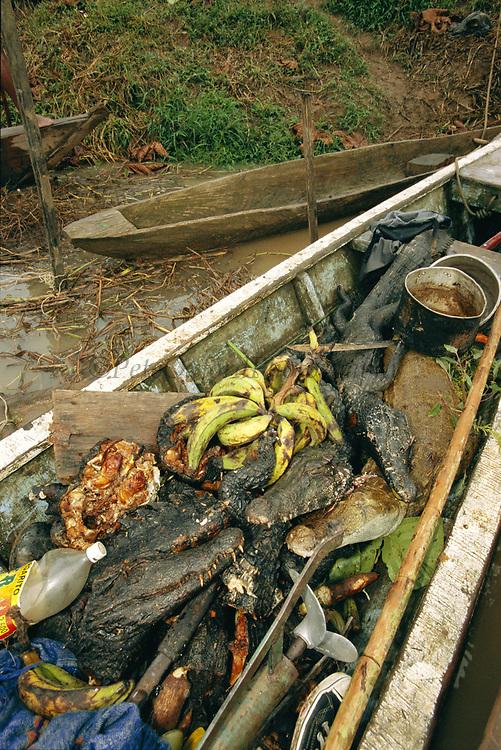Bushmeat in Canoe<br />Boca Mishagua River<br />Amazon Rain Forest.  PERU   South America<br />Canoe contains caiman, monkeys, Tortoises and peccary.