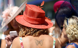 A female facegoer with a butterfly tattoo during day three of Royal Ascot at Ascot Racecourse.