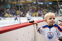 KELOWNA, CANADA - OCTOBER 2: A young Edmonton Oilers' fan stands at the glass after catching a puck against Los Angeles Kings on October 2, 2016 at Kal Tire Place in Vernon, British Columbia, Canada.  (Photo by Marissa Baecker/Shoot the Breeze)  *** Local Caption ***