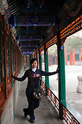 Chinese woman poses for a photograph at The Summer Palace, Beijing, China
