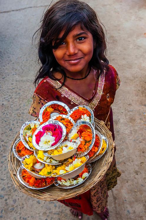 Girl selling puja offerings, Mathura, Uttar Pradesh, India.