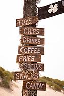 signpost at the beach pavilion Aloha Beach near Vrouwenpolder on the peninsula Walcheren, Zeeland, Netherlands.<br /> <br /> Schilder am Strandpavillon Aloha Beach bei Vrouwenpolder auf Walcheren, Zeeland, Niederlande.