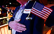 Ron Fultz stands with his hand over his heart during the National Anthem at a campaign even for Republican U.S. Representative Marsha Blackburn Sunday, Oct. 28, 2018, in Nashville, Tenn.
