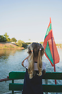 A young girl enjoys a late afternoon boat cruise on the Dniester River near the Transnistrian city of Tiraspol. Transnistria was formed after the dissolution of the USSR, when in 1992 tensions between Moldova and the Transnistrian territory escalated into a military conflict. A ceasefire several months later ended hostilities but did not resolve the political conflict. Today Transnistria is an unrecognized but de facto independent republic.