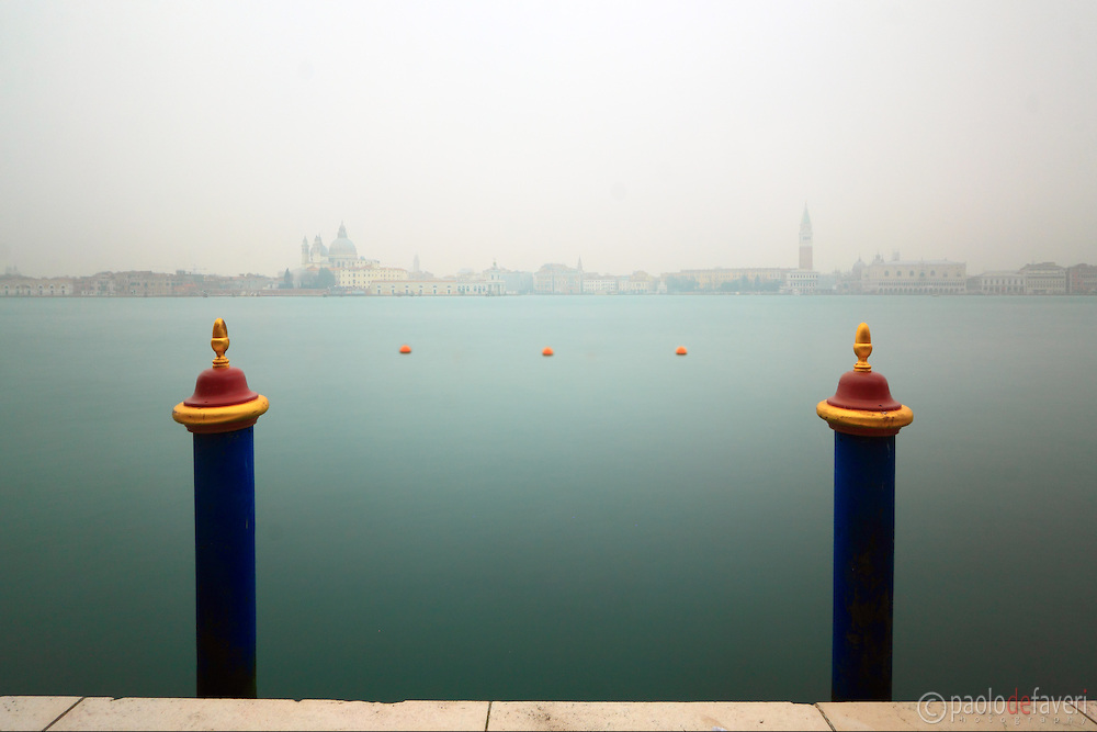 A moody, surreal view of the Basin in front of San Marco square from the quay of Giudecca. Taken on a foggy early morning of mid January, this is a very long exposure obtained by mean of a strong neutral filtration.