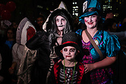New York, NY - 31 October 2019. the annual Greenwich Village Halloween Parade along Manhattan's 6th Avenue. A child and adults, all in costume.