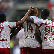 Thierry Henry, (centre), New York Red Bulls, is congratulated after scoring by team mates Tim Cahill, (left) and Bradley Wright-Phillips during the New York Red Bulls Vs Columbus Crew, Major League Soccer regular season match at Red Bull Arena, Harrison, New Jersey. USA. 12th July 2014. Photo Tim Clayton