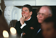 President Ronald Reagan listening to remarks of President De La Madrid of Mexico on May 15, 1984<br />Photo by Dennis Brack