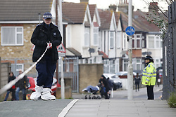 © Licensed to London News Pictures. 20/01/2020. London, UK. Police inspect a pavement where blood spots were found near a murder scene in Seven Kings in east London as an investigation is launched into the deaths of three men all of whom had suffered apparent stab injuries. Photo credit: Peter Macdiarmid/LNP
