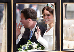 Princess Eugenie and her husband Jack Brooksbank travel in the Scottish State Coach during the carriage procession following their wedding at St George's Chapel, Windsor Castle. Photo credit should read: Doug Peters/EMPICS