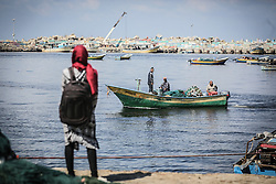 October 5, 2016 - Gaza, Palestine - Palestinians show their solidarity with a Gaza-bound flotilla of international activists attempting to break the Israeli blockade on the Hamas-run Gaza Strip, on October 5, 2016 at the port in Gaza City. A group of women will try to reach the Gaza Strip on board a boat in a bid to break a decade-long blockade by Israel, a spokeswoman said. The flotilla dubbed 'Women's Boat to Gaza', is part of the wider Freedom Flotilla Coalition that consists of pro-Palestinian boats that regularly go to Gaza from all over the world to try to break the blockade. (Credit Image: © Momen Faiz/NurPhoto via ZUMA Press)