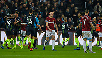 Football - 2018 / 2019 Premier League - West Ham United vs. Manchester City<br /> <br /> Declan Rice (West Ham United) and Marko Arnautovic (West Ham United) show their disappointment as Manchester City players celebrate at the London Stadium<br /> <br /> COLORSPORT/DANIEL BEARHAM