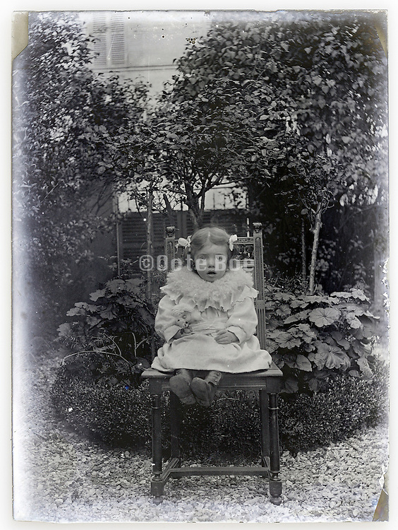 glass plate with toddler girl in garden setting