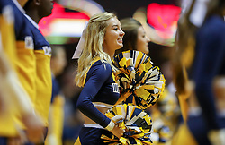 Nov 24, 2018; Morgantown, WV, USA; A West Virginia Mountaineers cheerleader performs during the first half against the Valparaiso Crusaders at WVU Coliseum. Mandatory Credit: Ben Queen-USA TODAY Sports