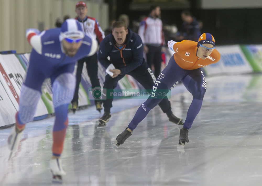 March 9, 2019 - Salt Lake City, Utah, USA - A coach yells encouragement as Marcel Bosker of the Netherlands (R) and Alexander Rumyantsev of Russia (L) compete in the 5000m speed skating finals at the ISU World Cup at the Olympic Oval in Salt Lake City, Utah. (Credit Image: © Natalie Behring/ZUMA Wire)