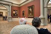 elderly people taking a break while watching art inside the Metropolitan Museum of Art