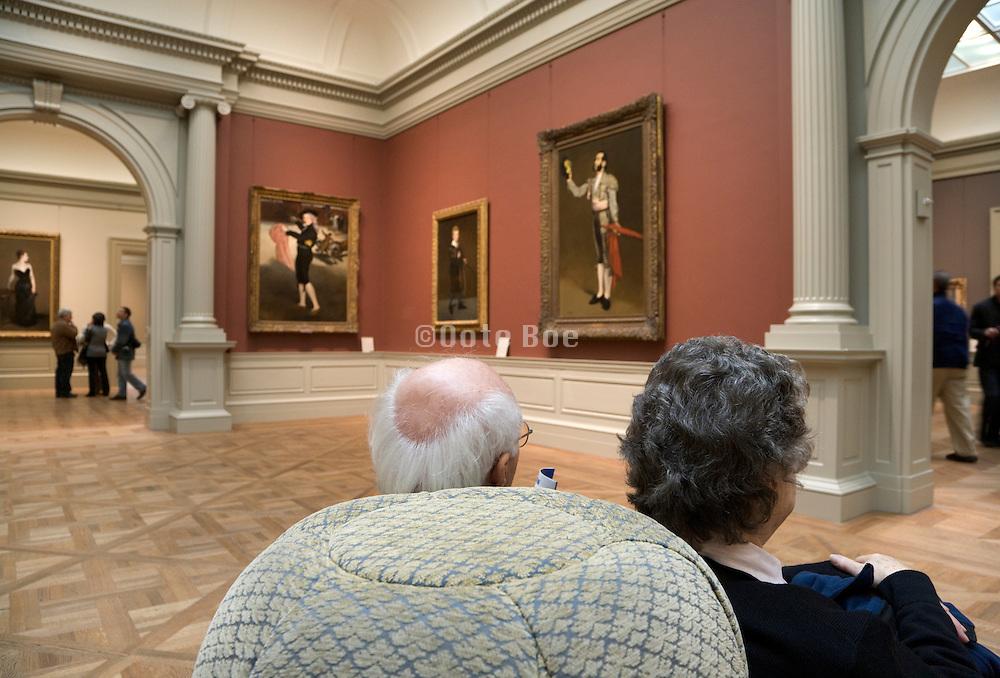 elderly people taking a break while watching art inside the Metropolitan Museum of Art