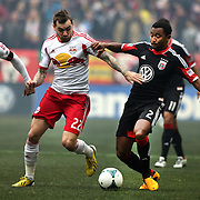 James Riley, D.C. United, (right) is challenged by Jonathan Steele, New York Red Bulls,  during the New York Red Bulls V D.C. United, Major League Soccer regular season match at Red Bull Arena, Harrison, New Jersey. USA. 16th March 2013. Photo Tim Clayton