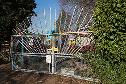 London, UK. 26th February, 2019. The entrance to Grow Heathrow, a squatted eco-community founded in 2010 on a previously derelict site close to Heathrow airport in protest against government plans for a third runway. Bailiffs from the National Eviction Team today evicted residents from the front section of the site owned by Imran Malik, removing several protesters locked on in towers above the camp, but four protesters are believed to remain in a tunnel beneath that area. Many more protesters remain on the rear portion of the site. Five legal challenges to the government's approval of a 3rd runway at Heathrow will proceed to judicial review at the Royal Courts of Justice on 10th March.