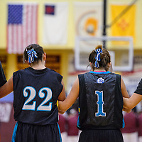 Players on the Navajo Prep girls varsity squad wear their hair in a traditional bun called a tsiiyeel as the line up to take the court against the Rehoboth Lynx Friday at Rehoboth High School.