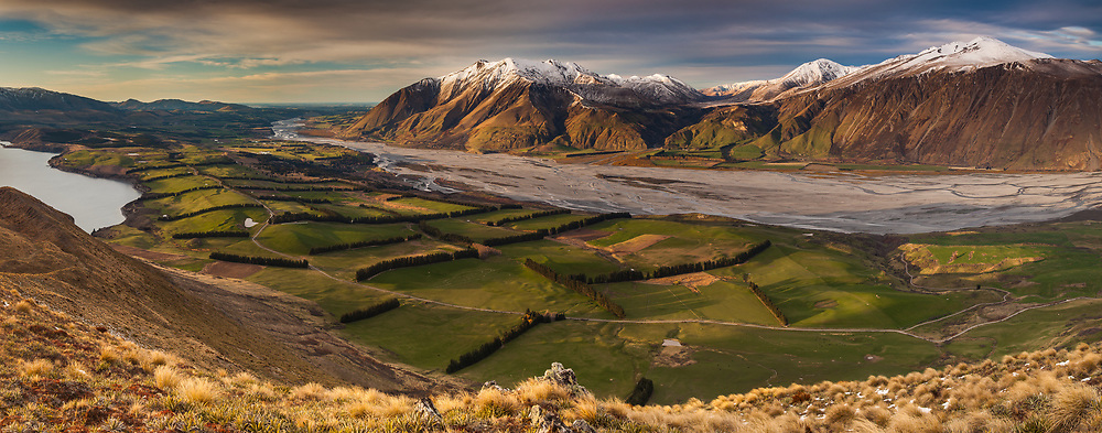 Sheep and cattle farms use windbreaks to shelter stock from wind that drives down Rakaia river valley from Southern Alps, panorama from Peak Hill Conservation Area, Canterbury
