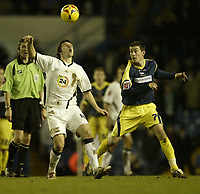 Photo: Aidan Ellis.<br /> Leeds United v Derby County. Coca Cola Championship. 09/12/2006.<br /> Leeds Jonathon Douglas (L) is closely watched by Derby's David Jones
