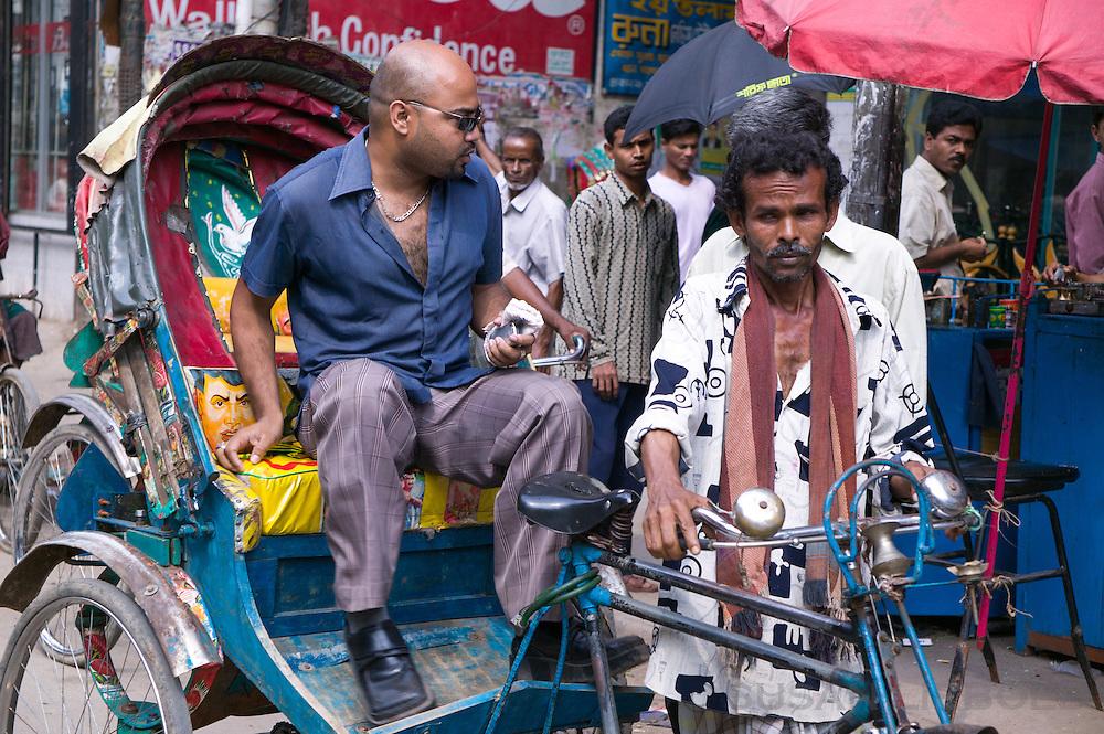 Jalal waiting for customers to get into his rickshaw in Dhaka, Bangladesh.